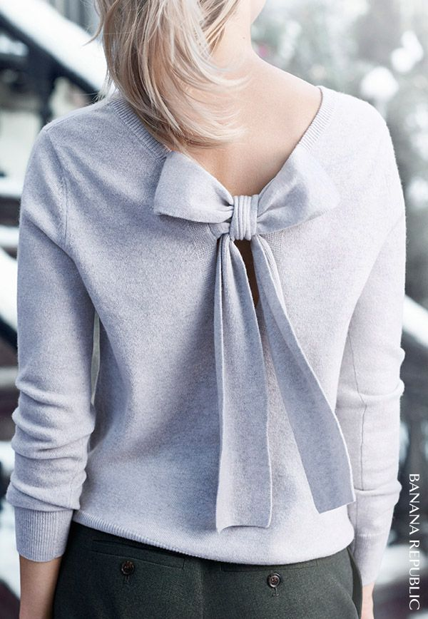 "So beautiful coming or going. 100% cashmere bow-back sweater spun from Scottish mill Todd & Duncan yarns. Add a soft touch of femininity for 9-5 & beyond. Or RSVP ""yes"" and chicly make an entrance & exit at upcoming holiday festivities. 