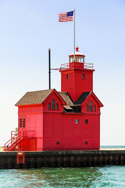 Holland Big Red Lighthouse It's a great picture, but why does it have an American flag? Figured it out. It's in Holland, Michigan.