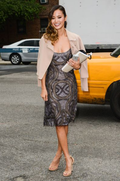 Actress Jamie Chung leaves the Mercedes-Benz Fashion Week at Lincoln Center for the Performing Arts on September 9, 2014 in New York City.  (Photo by Ray Tamarra/GC Images)