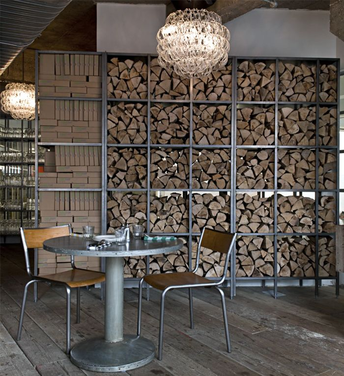 Chopped wood is not just meant for fuel anymore...it's decoration! Paired with metal and wood furniture creates a great atmosphere...  http://www.parknpool.com/products/71/publish/english/71ch-002-norden-stacking-arn-chair-teak-seat-3221.php