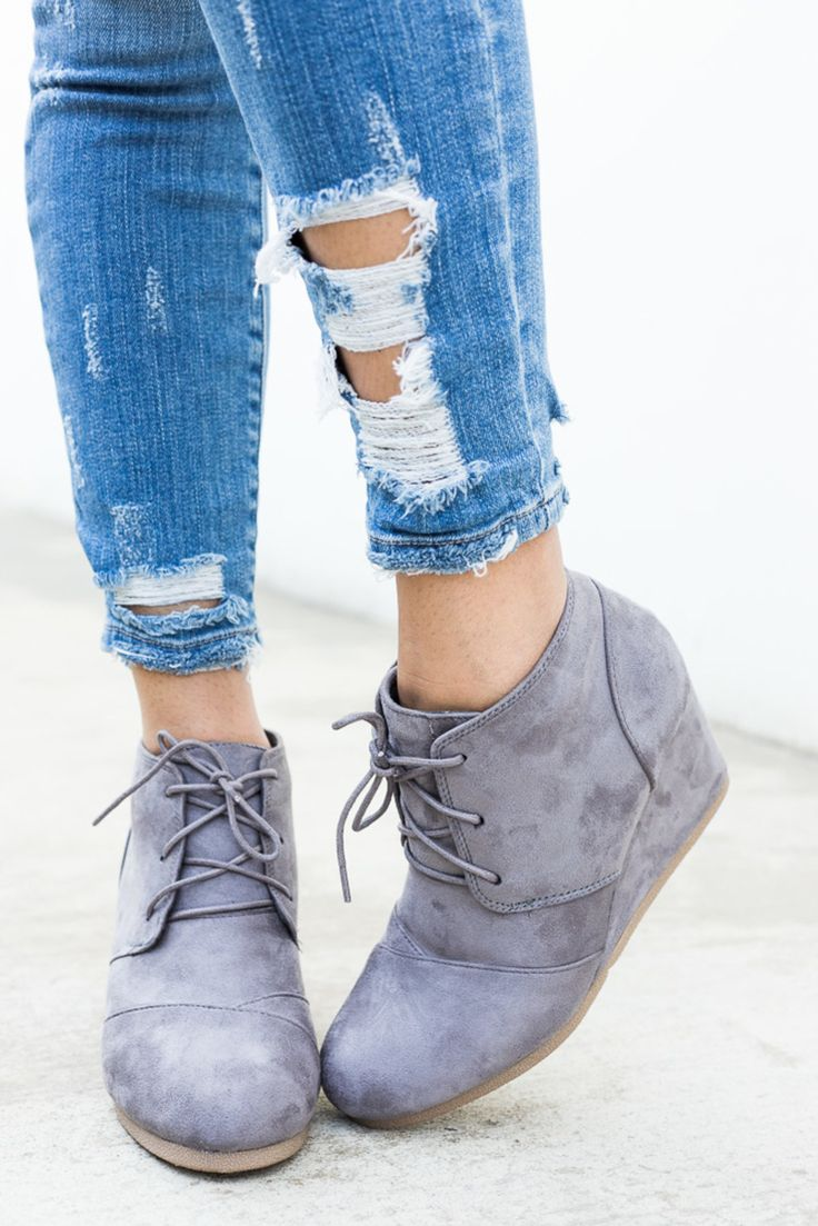 """Prep up your look in these cute and chic oxford ankle bootie wedges! Designed with a lace tie-up, overlap detailing, faux suede material, cushioned insole, and approx. a 3"""" wedge."""