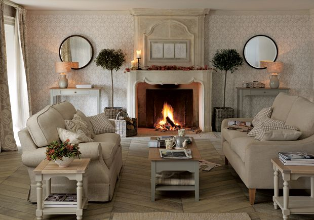 Laura Ashley - 2nd pic of same living room showing sofas facing one another beside the fireplace