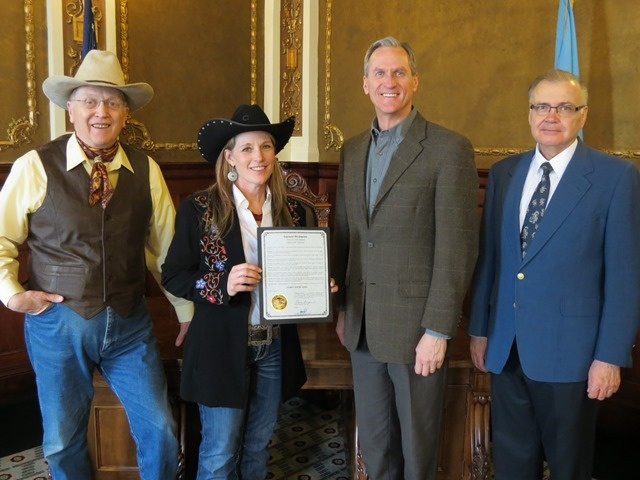2013 Cowboy Poetry Week Proclamation. Right is Executive Director