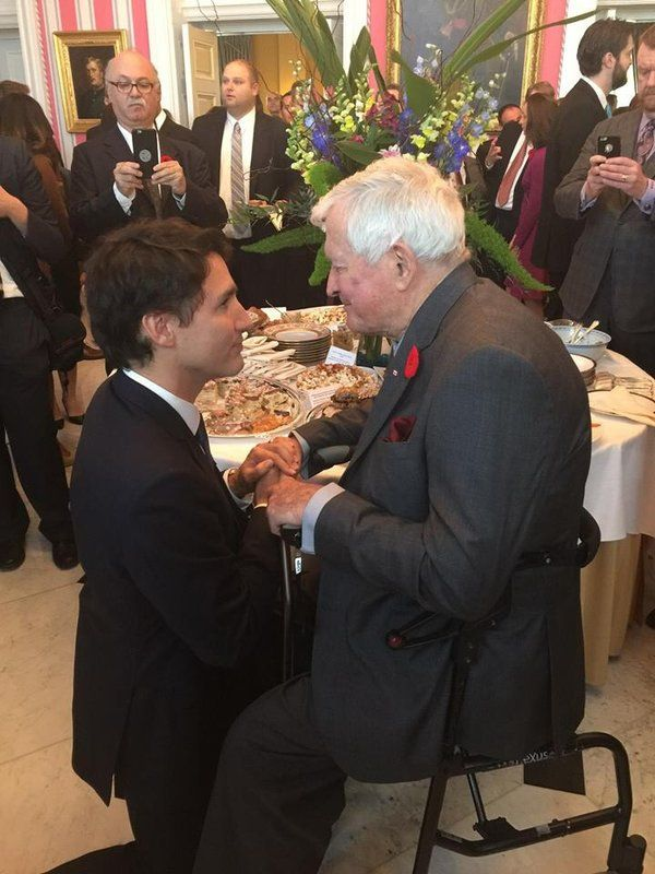 Photo show PM #Trudeau kneels down to greet great John #Turner. Respect and Humility shows the measure of the Man!