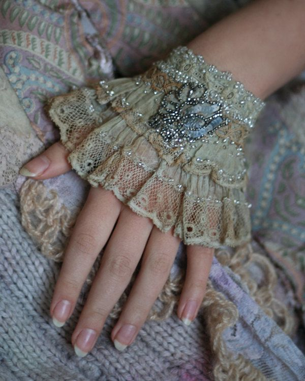 Sotto voce, very delicate romantic wrist cuff from antique batiste and laces. $66.00, via Etsy.