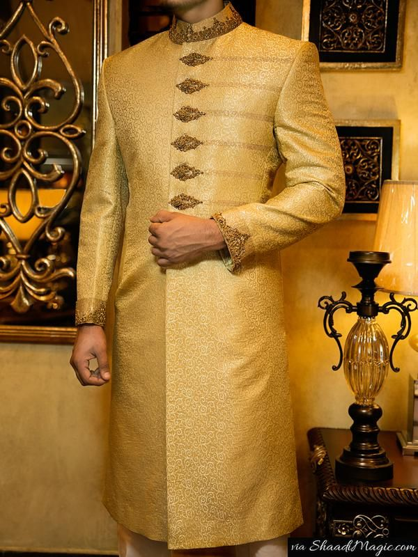 Junaid-Jamshed-golden sherwani. The wedding outfit for the groom of plain classy touch is always right for any man of the day.