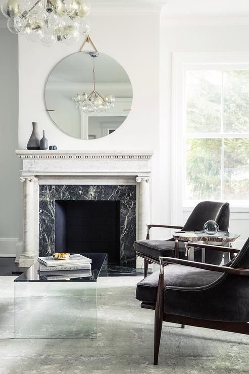 White marble fireplace with black marble surround #BHfamroom