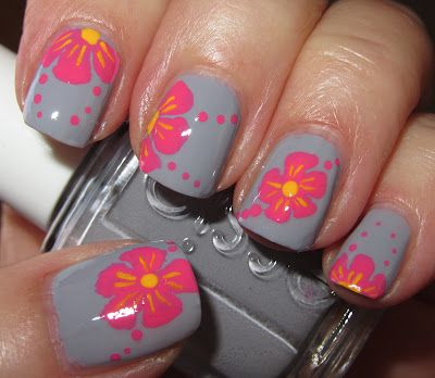 Tropical pink flowers on grey nails
