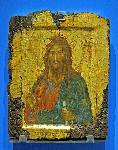 Icon of St John the Baptist The paint is  applied on a wooden panel,prepared with linen and  gesso surface. Constantinople,around  1300