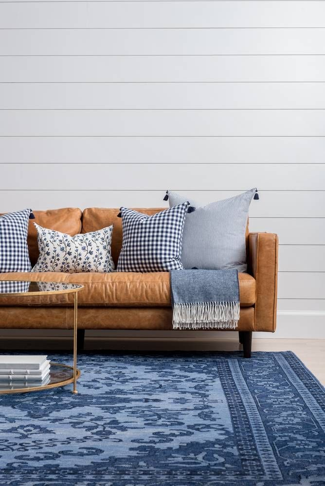 blue rug + leather couch