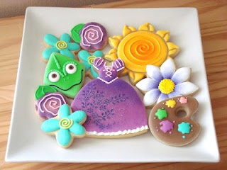 The cutest cookies you will ever find at www.sugarblisscookies.blogspot.com. I LOVE these Rapunzel ones;)