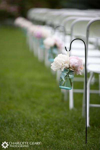 Pink and white peonies in mason jars, hung from shepherds hooks