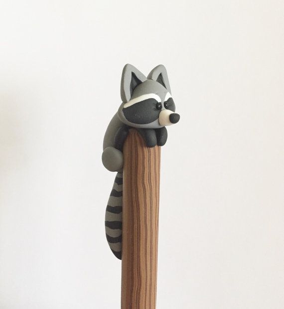 This curious raccoon has climbed up a pole to get a better look around your desk. Waiting for break time snacks, he can help you with writing a grocery list or maybe a lunch order. He is a well behaved raccoon for the most part and wont run around making a mess!    *This pen is decorated by me, all by hand.    *Instructions for refilling are included.