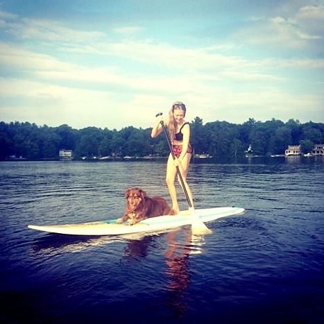 Ruff life! Amanda Seyfried takes her dog Finn for a paddleboard ride. The actress looks amazing in her stylish bikini, check out those toned legs!