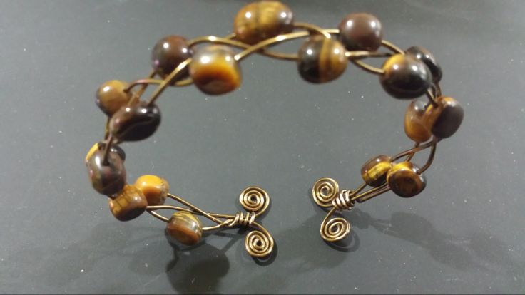 Hand crafted Antique Bronze Plaited Bangle with Yellow Tigers Eye nuggets and Spiral detail