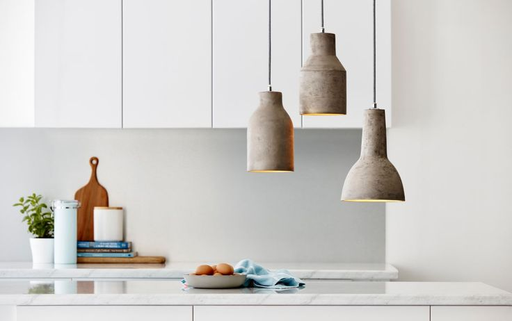 The Home Design Teramo concrete pendant is natural grey concrete in colour on the outside with a gold interior #kitchen #pendant #bunnings