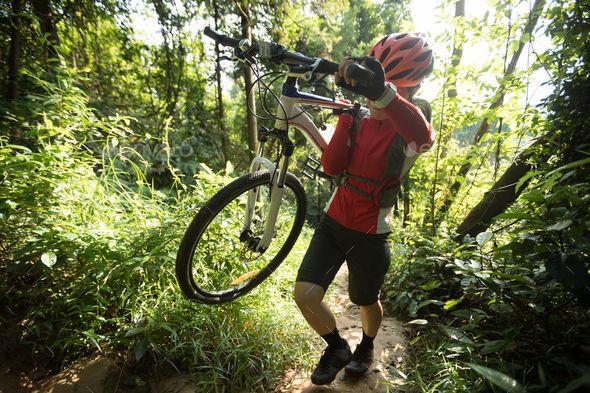 Woman Cyclist Carrying A Mountain Bike Climbing On Mountain Forest By Lzf Woman Cyclist Carry A Mountain Bike Walking O In 2020 Female Cyclist Mountain Biking Cyclist
