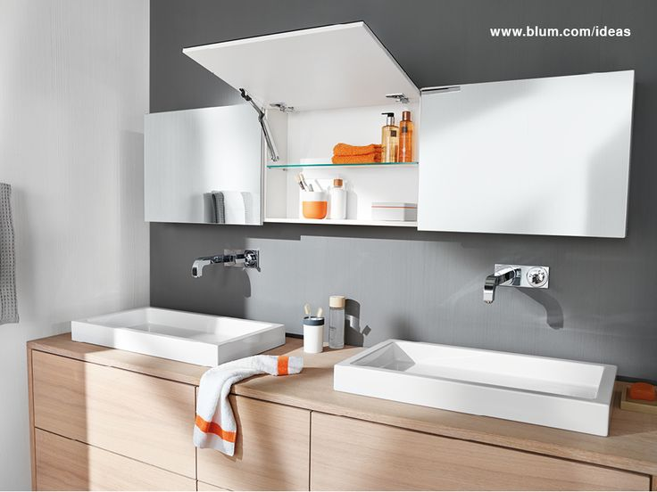 Mirror cabinet with Blum AVENTOS HK-XS lift system. It opens easily and closes silently with BLUMOTION dampening system. Due to its narrow style, it offers a high level of design freedom for small top wall cabinets. More ideas for Blum products in your bathroom on www.blum.com/ideas