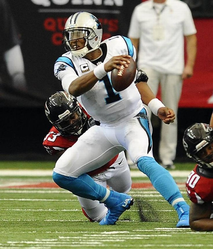 Carolina Panthers quarterback Cam Newton (1) gets sacked by Atlanta Falcons defensive end Dwight Freeney (93) in the first half at the Georgia Dome in Atlanta, Ga. on Sunday, October 2, 2016.