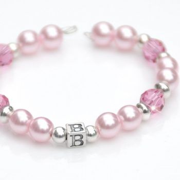 Crafted with baby pink Swarovski pearls and sparkling pink blush Swarovski crystal, your little girl will feel very grown up in this. Scattered through with dainty sterling silver beads and a sterling silver accent bead with you child's initial