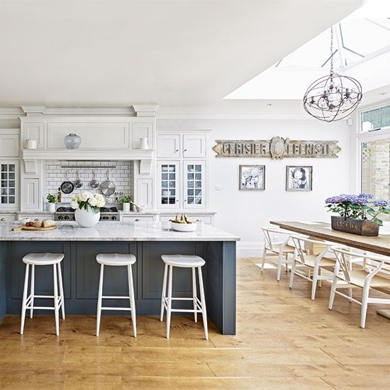 The bold move to paint this large island dark grey makes the white and wood surrounding it stand out as well as complementing them perfectly. http://www.housetohome.co.uk/room-idea/picture/country-kitchen-diner-design-ideas-10-of-the-best/2