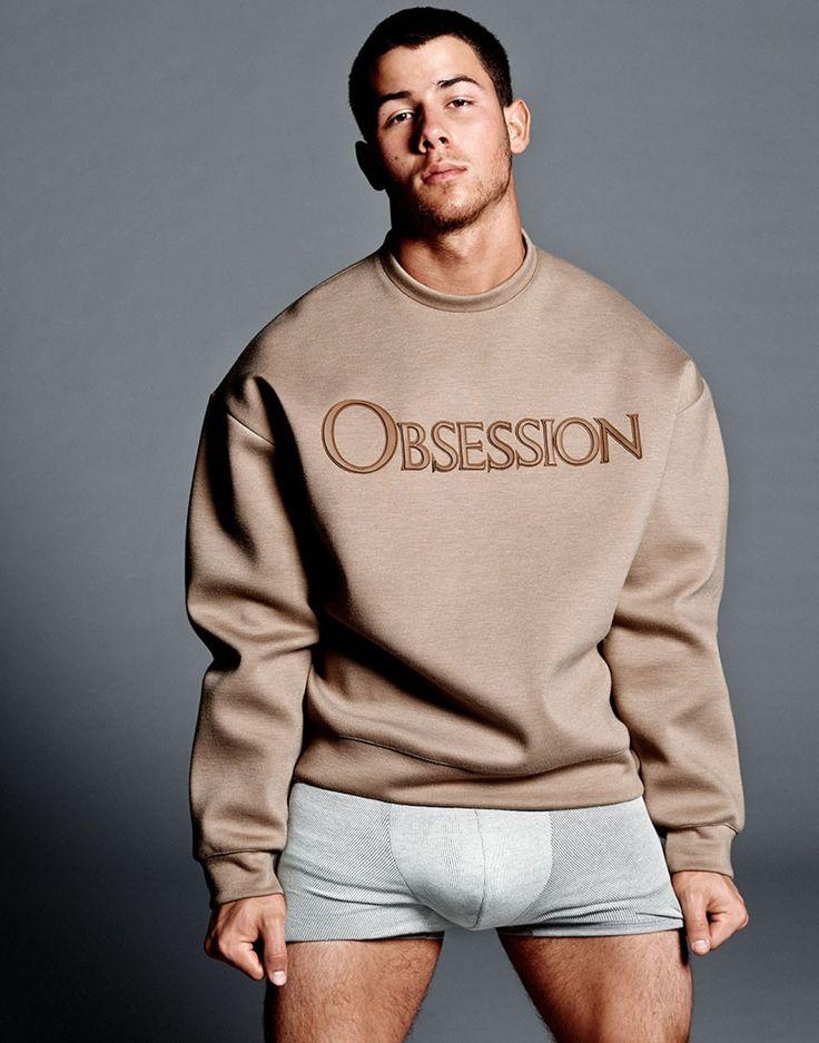 Nick Jonas wearing a Calvin Klein OBSESSION logo sweatshirt, for Flaunt Magazine.