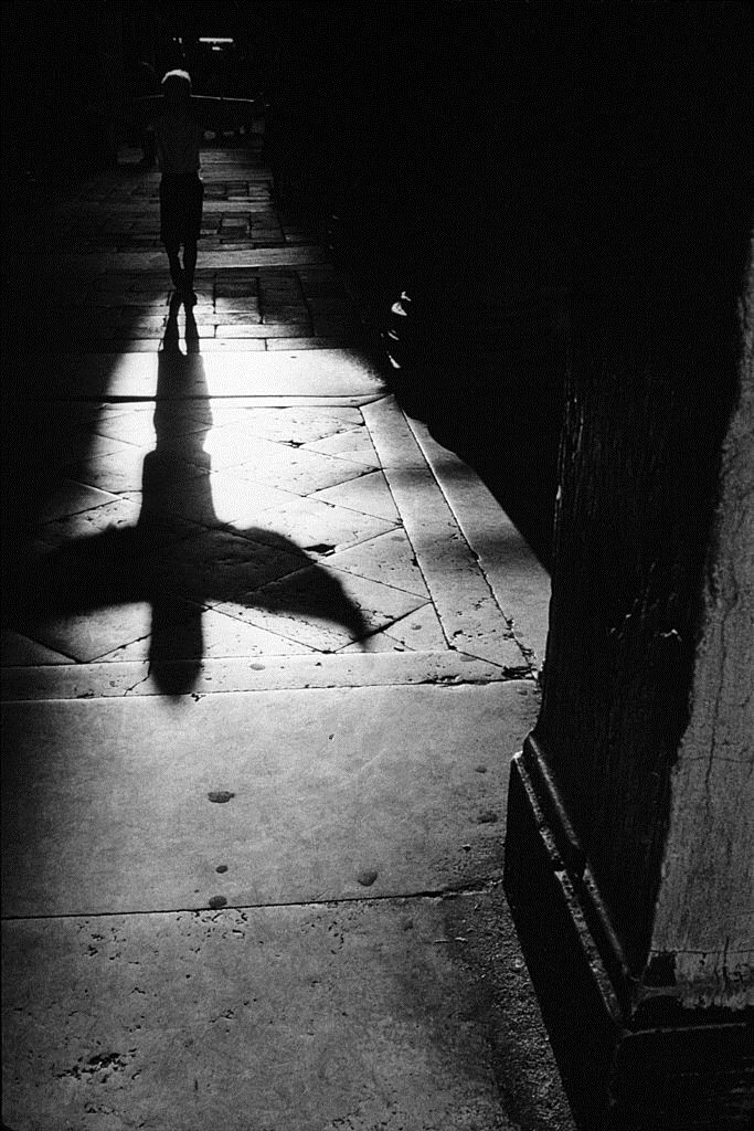 mezzaluna|me · shadow of a child playing with his sweater near...