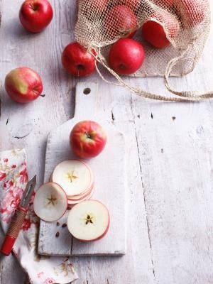 This Sweet Apple Kugel Is Dairy Free and Kosher for Passover: Sliced apples on wooden board