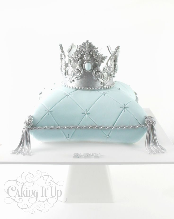 Hand carved regal baby blue and silver prince crown and cushion cake. Hand made sugar crown.