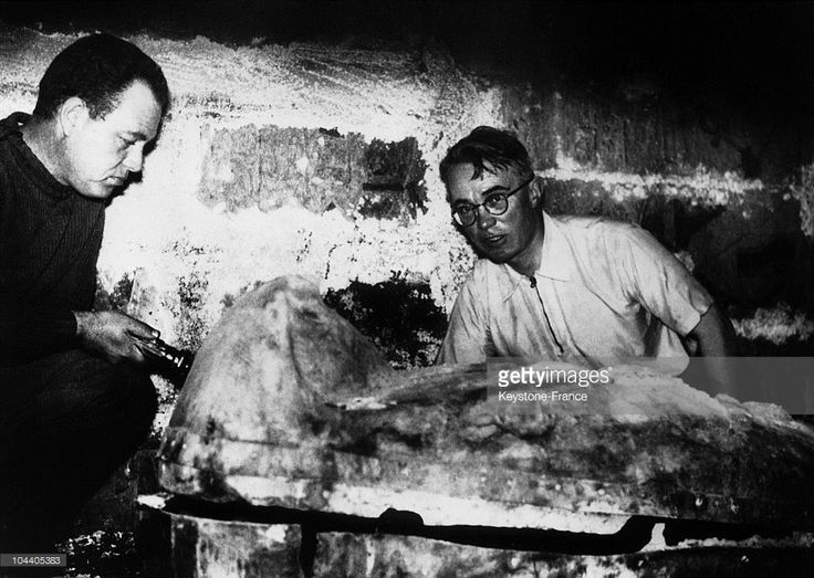 In March 1939 in Tanis (present-day San-el-Hagar) in the Nile Delta in Egypt, Professor MONTET from a French scientific mission (background) discovered the solid silver sarcophagus of Pharaoh PSUSENNES II, whose original name was Titkheperoure Setepenamon (984-950 B.C.), king fom the XXIth dynasty and supposed father-in-law of King SOLOMON of Israel. Two other pink granite sarcophagi were found with this one.