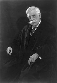 """Oliver Wendell Holmes Jr circa 1930\""""The right to swing my fist ends where the other man's nose begins."""" Holmes, like his father, was a Unitarian, who believed in a god, but was creedless. D. 1935."""