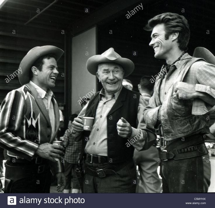 CLINT ESTWOOD at right with unidentified members cast members of the TV series 'Rawhide' about 1960