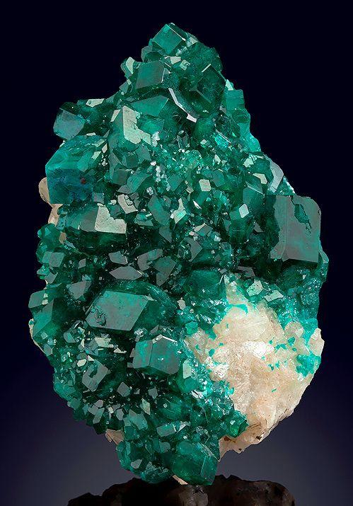 Dioptase covering a white Calcite crystal matrix ~ Tsumeb Mine, Tsumeb, Otjikoto Region (Oshikoto), Namibia