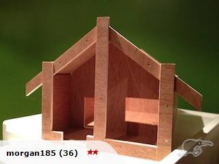This is a self-assembled wharenui. A small model of a traditional maori wharenui with a detachable roof to be used as a teaching tool a toy or anything you can imagine.