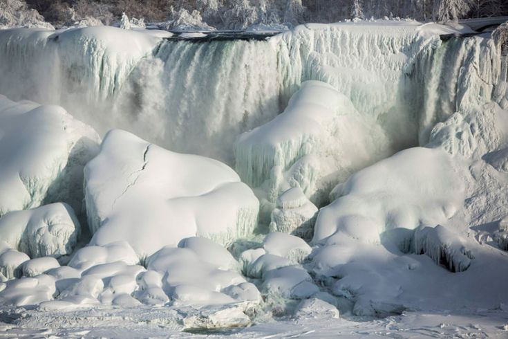 A partially frozen American Falls in sub freezing temperatures is seen in Niagara Falls, Ontario. Temperature dropped to -14 Celsius. The National Weather Service has issued Wind Chill Warning in Western New York from midnight Wednesday to Friday.   February, 2015.