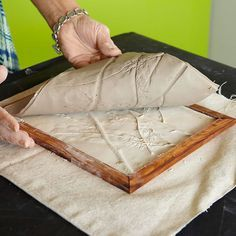 after rolling out clay into the frame, impressing with twigs, leaves, etc. Pour plaster over and let set, peel away clay