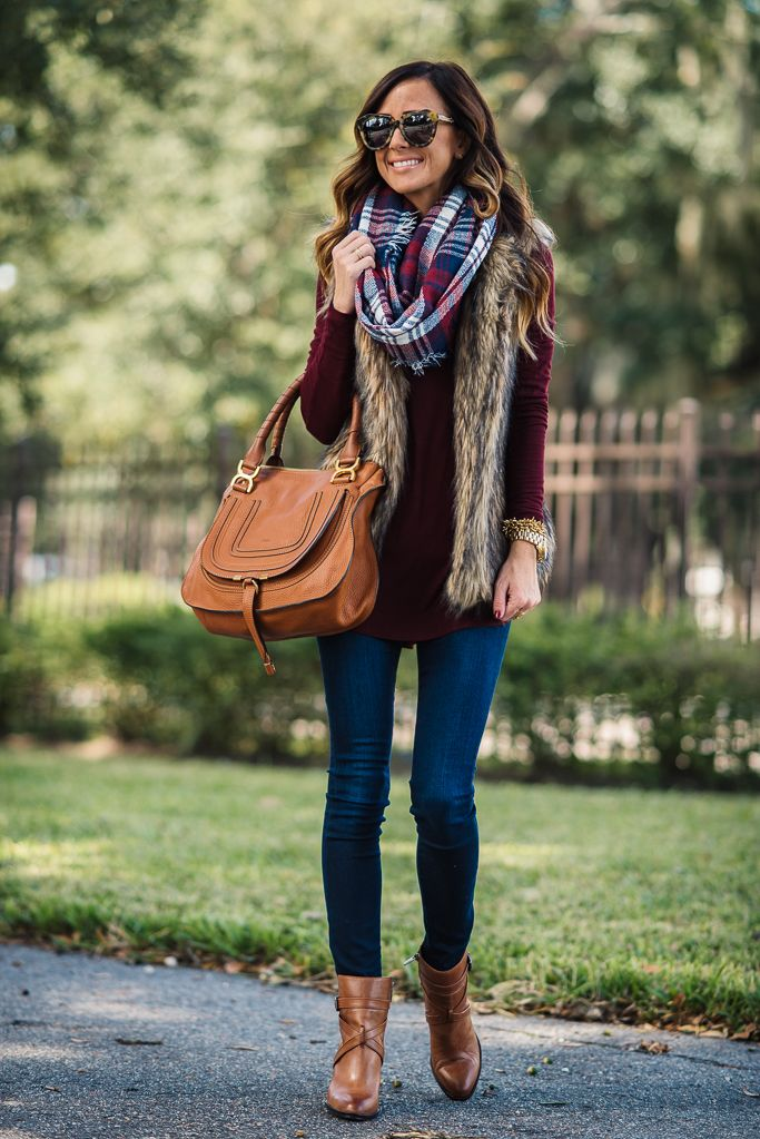 burgundy top, denim jeans, ankle boots or riding boots, fur vest, plaid scarf