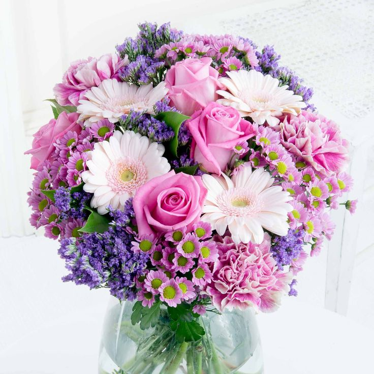 Loveable Pastels - Make any occasion extra special with this adorable arrangement in pink and lilac tones.