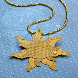 Free template for golden sun medaliion, for even cheaper could use a gold necklace string, instead of beads. . . golden sun template will also work to use for other decorations, ect,