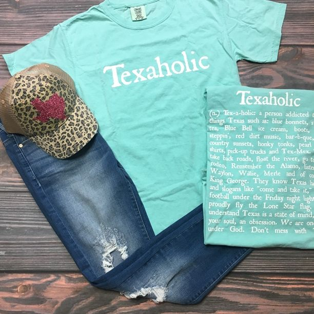 Restocked  Texaholic Texas Tee in Mint (S-XL) - Texaholic!  Mint Tee with all the things we love about Texas on the back Front says Texaholic in White Comes on a Comfort Colors Unisex Tee I suggest ordering regular t shirt size. I am a size 6-8 and like the medium for a loose fit!