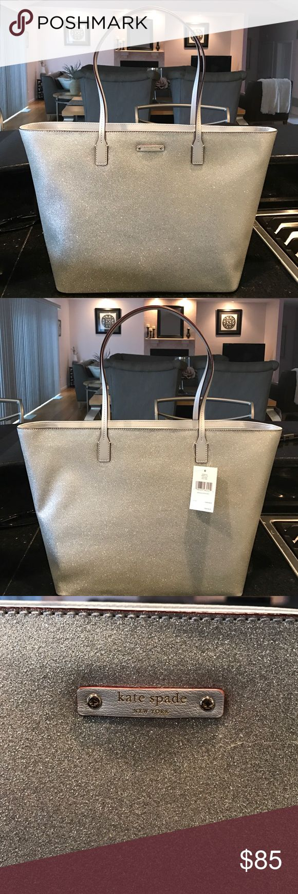 Kate Spade Tote Bag It is a glitter-like silver tote bag with a zipper across the top. There is also two pockets and a zipper pocket inside the bag. This bag is brand new and never used kate spade Bags Totes