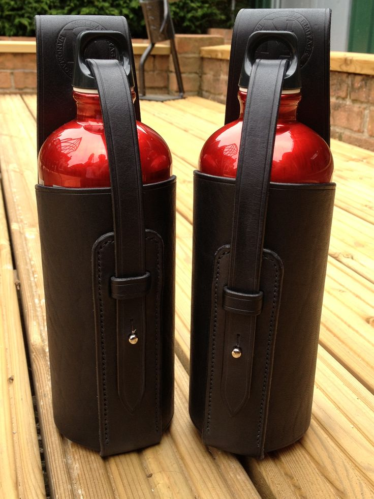 Someone wanted to follow a fire extinguisher theme for water bottles. These are a couple of cases for 1lt Sig bottles to be worn on the belt.