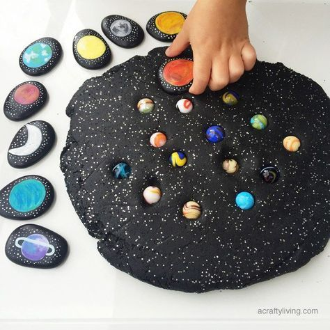 This simple invitation to play includes home-made Space Story Stones, planet marbles and of course our Galaxy Dough! We also added some (non-edible) glitter to achieve the full GALAXY effect!