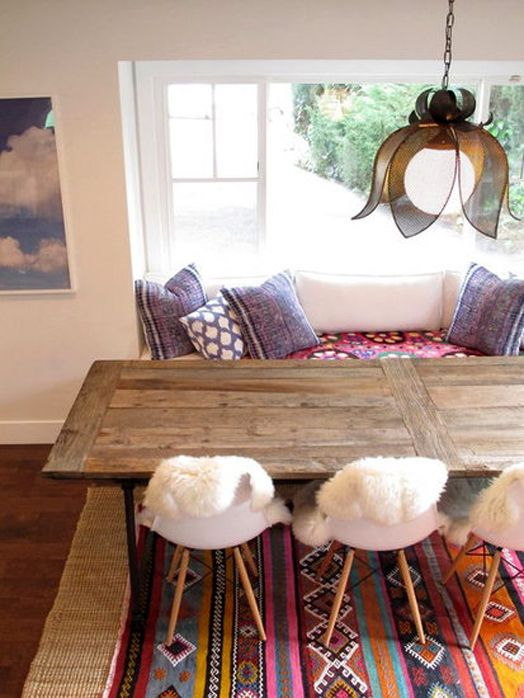 kilim rug, sea grass rug, rustic table, white Eames chairs, white walls.  just my style!