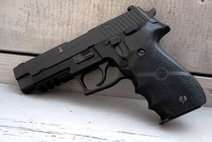 Sig Sauer P226, the service pistol of the US Navy SEALs. A friend of mine, an old judge, swears by this pistol. After a convict ran amok in open court, he started carrying his P226 in a shoulder holster under his black robe.
