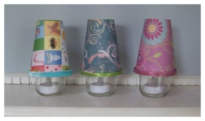 baby food jar crafts baby night lights..... Use this easy baby food jar crafts to make the cutest little baby night lights to match any nursery theme or colors. These are so quick and easy to make. I've used battery operated LED tea lights to illuminate these little lamps. The lamp shade is made from a paper cup. You can decorate the lamp shade with scrapbook or decorative paper or even fabric