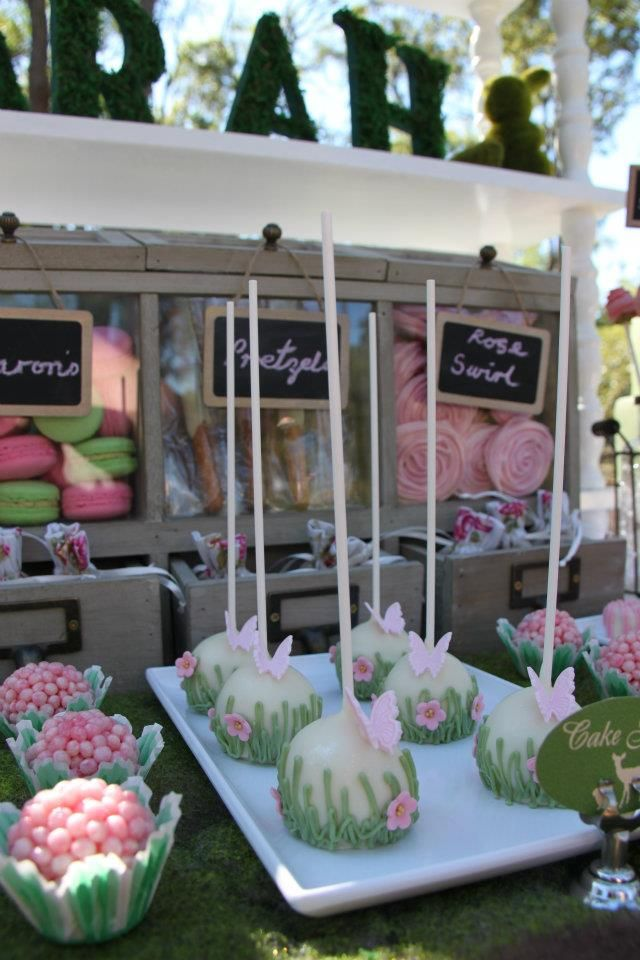 Pretty Cake Pops and love the set up of the sweets table wit the drawers