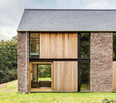 Steel frame house clad in stone and timber