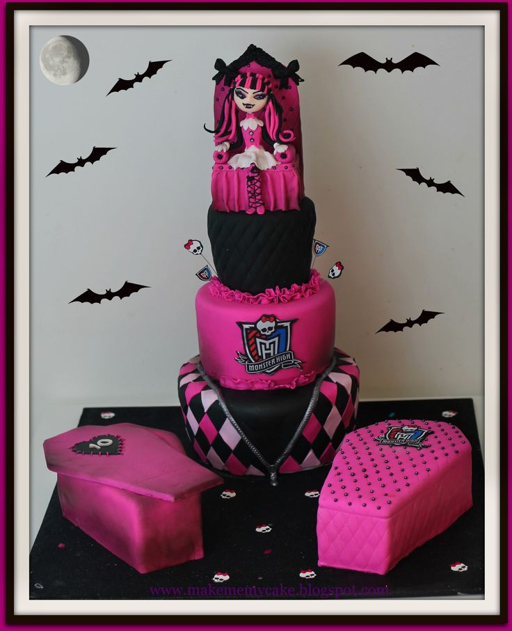 Monster High Cake - Red velvet cake with cream cheese filling. Coffins also red velvet cake. Draculaura made out of fondant.