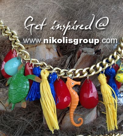 Detail from necklace with tassels, acrylic drops and pvc animals! find all the materials @ www.nikolisgroup.com
